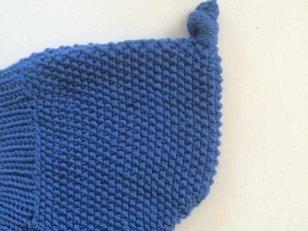 Detalj av strikket lue